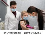 a nurse is making an vaccine to ... | Shutterstock . vector #1895393263