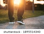 Man Walking Outdoors In The...