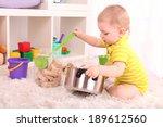 cute little boy plating in room | Shutterstock . vector #189612560