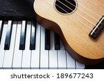 Piano Key And Ukulele. Art And...