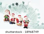 santa figures with tinsel... | Shutterstock . vector #18968749
