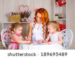 happy mother with two girls... | Shutterstock . vector #189695489