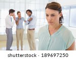 colleauges gossiping with sad... | Shutterstock . vector #189697250