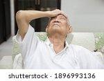 asian senior man grab his... | Shutterstock . vector #1896993136