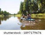A Couple Of Men And Women Kayak ...