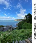 Devon Coastline With Mountain...