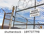 run down metal fence has a sign ... | Shutterstock . vector #189737798