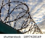 Barbed Wire On The Fence In The ...
