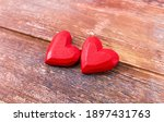 Two Red Handmade Wooden Carved...