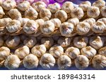 garlic bunches stacked in a row ...