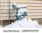 Natural Gas Meter Covered In...