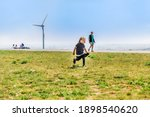 Girl Running On Top Of Hill...