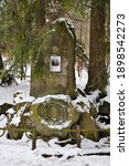 "Small photo of Swieradow Zdroj resort, Poland, December 17, 2018: Memorial stone to industrialist and inventor from Berlin Julius Karl Pinch who built Recreation Center ""Marzenie"" in 1901"