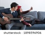 young asian couple taking a... | Shutterstock . vector #1898596906