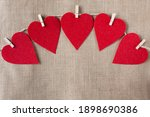 Five Red Hearts On Wooden Pegs...