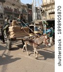 An Overloaded Donkey Cart On...