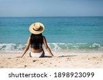 Woman In Bikini Resting On The...