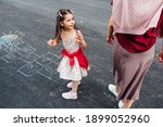 Outdoor Image Of A Little Girl...