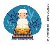 cute muslim boy sitting while... | Shutterstock .eps vector #1899202693