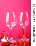 Two Champagne Glasses With...