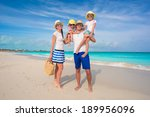 happy family of four on beach... | Shutterstock . vector #189956096
