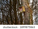 A Wooden Bird House With A...