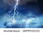 Lightning In Dark Cloudy Sky...