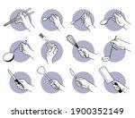 Hand Holding Kitchen Utensils...