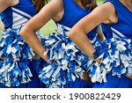 Cheerleaders in uniform holding ...