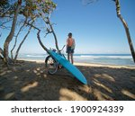 Surfer Girl Stands With Bicycle ...