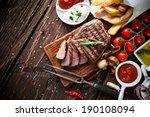 delicious beef steak on wooden... | Shutterstock . vector #190108094