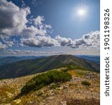 Summer sunshine above Carpathian mountains. View from stony Vysoka Mountain to Ihrovets and other Gorgany massive mountains, Ukraine.