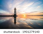 Lighthouse Standing In Pool Of...