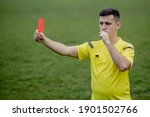 Referee showing a red card to a ...