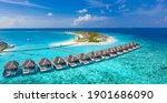 Small photo of Maldives paradise scenery. Tropical aerial landscape, seascape with long jetty, water villas with amazing sea and lagoon beach, tropical nature. Exotic tourism destination banner, summer vacation