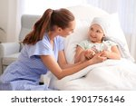 Small photo of Woman visiting her daughter who is undergoing course of chemotherapy in clinic. Childhood cancer awareness concept