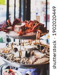 Small photo of French 2 tiers seafood platter with dry ice on top and smoke coming down. Seafood including Tasmanian giant crab, raw oysters, scallop, shrimps, king prawns and mussels.