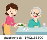 woman serving food to elderly... | Shutterstock .eps vector #1902188800