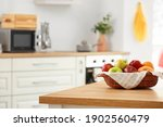 Basket With Fresh Fruits On...