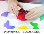 Close Up Of Child's Hands Using ...