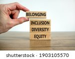 Small photo of Equity, diversity, inclusion and belonging symbol. Wooden blocks with words 'equity, diversity, inclusion, belonging' on beautiful white background. Diversity, equity, inclusion and belonging concept.