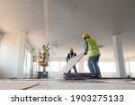 Small photo of Construction worker installation ceiling work
