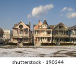 This is a colorful group of victorian houses in Ocean Grove NJ during the winter months.  - stock photo