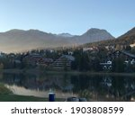 Lake Reflecting Chalets In...