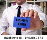 Small photo of Business concept about Customer Churn with inscription on the sheet.