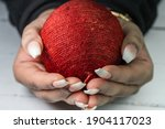 Woman Holding On To Ball....