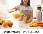 Young Woman Pouring Tasty Fresh ...
