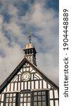 Tudor House With Cloudy Blue Sky