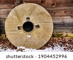 Millstone Leaning Against Old...