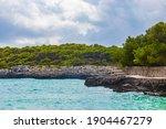 Small photo of Turquoise beach and cliffs ses Fonts de n'Alis in bay Calo d'en Garrot Mallorca Spain.